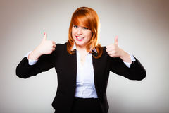 Business woman giving thumbs up sign Stock Photo