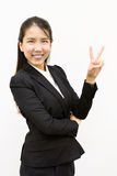 Business woman giving victory Royalty Free Stock Image