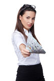 Business woman giving you us dollar Stock Photo