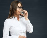 Business woman with glass drinking water. Studio isolated portrait. white shirt Stock Photos