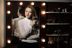 Business woman with glass red wine Royalty Free Stock Photography