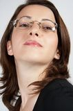 Business woman with glasses 02. Beautiful business woman in black looking confident stock images