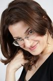 Business woman with glasses 03. Beautiful business woman in black smiling and looking confident Royalty Free Stock Photo