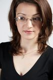 Business woman with glasses 04. Beautiful business woman in black royalty free stock image