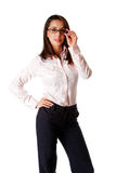 Business woman with glasses. Beautiful smart successful Caucasian Hispanic entrepreneur business woman standing, wearing dark blue pants and pink shirt with hand Royalty Free Stock Photos