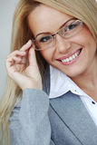 Business woman in glasses. On gray background Royalty Free Stock Photography