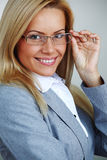 Business woman in glasses. On gray background Royalty Free Stock Photos