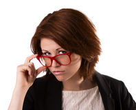 Business woman in glasses. Beautiful young business woman in red glasses, isolated on white background Royalty Free Stock Photography