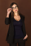Business woman in glasses and a black suit Stock Photography