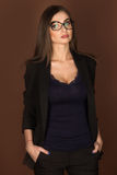 Business woman in glasses and a black suit Stock Images