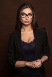 Business woman in glasses and a black suit Royalty Free Stock Photos