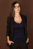 Business woman in glasses and a black suit Royalty Free Stock Photography