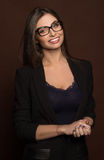 Business woman in glasses and a black suit Stock Photos