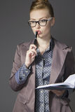 Business woman in glasses business woman in a suit thoughtfully Stock Photos
