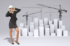 Business woman in glasses. Full lenght. Cubes with Royalty Free Stock Image
