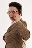 Business woman with glasses when phoning Stock Photos