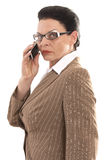 Business woman with glasses when phoning Stock Images