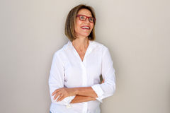 Business woman with glasses smiling. Portrait of business woman with glasses smiling Royalty Free Stock Photo