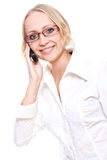 Business woman in a glasses with telephone Stock Image