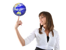 Business Woman with Globe. A pretty young business woman holding a globe on finger stock photos