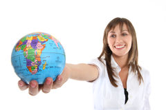 Business Woman with Globe. A pretty young business woman holding a globe royalty free stock photos