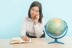 Business woman with the globe Stock Image