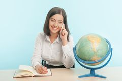 Business woman with the globe Stock Images