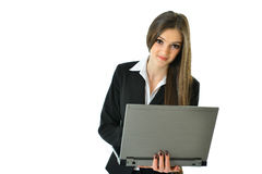 Business Woman on the Go. Holding a gray laptop Royalty Free Stock Image