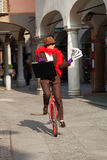 Business woman go to work in monocycle Stock Photography
