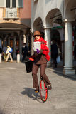 Business woman go to work in monocycle Stock Photo