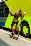Business woman go to work in monocycle. Woman through the city with the unicycle to go to work Royalty Free Stock Photography