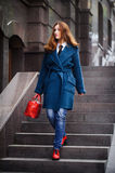 Business woman going to work. Business woman goes to work, Autumn. Concept Business fashion Stock Photo