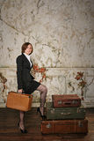 Business woman going on a trip. Young successful business woman is going into business travel. A girl holding a suitcase. Vintage background Royalty Free Stock Photos