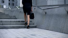 Business woman going upstairs, climbing career ladder, achieving goals and aims. Stock photo royalty free stock images