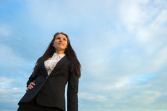 Business woman on green field Royalty Free Stock Images