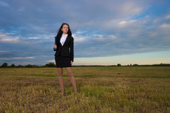 Business woman on green field. Young and beauty business woman on green field Royalty Free Stock Photo