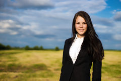 Business woman on green field. Young and beauty business woman on green field Royalty Free Stock Photos
