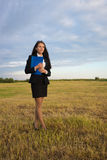 Business woman on green field Stock Photography