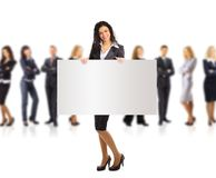 Business woman and group holding a banner ad. Full length portrait isolated on white background Royalty Free Stock Photo