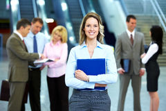 Business woman and a group of workers. Royalty Free Stock Photos