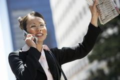 Business Woman Hailing A Cab Stock Image