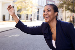 Business woman hailing taxi Royalty Free Stock Image
