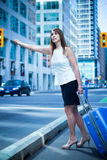 Business woman hails a taxi - filter applied Stock Photo