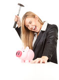 Business woman with hammer and piggy bank Stock Photo