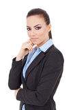 Business woman with hand on chin Royalty Free Stock Photography