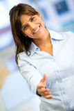 Business woman with hand extended Royalty Free Stock Photos