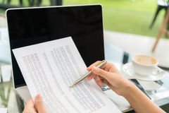 Business woman hand with Financial charts and laptop on the tabl Royalty Free Stock Photo