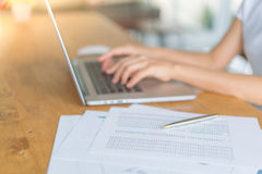 Business woman hand with Financial charts and laptop on the tabl Royalty Free Stock Image