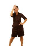 Business woman with hand on forehead smiling Stock Image