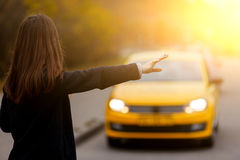 Business woman hand gesture stopping classic yellow taxi Stock Image